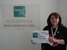 """A person holding a sign which reads """"Proud2Be a supporter of the LGBT community & ginger"""""""